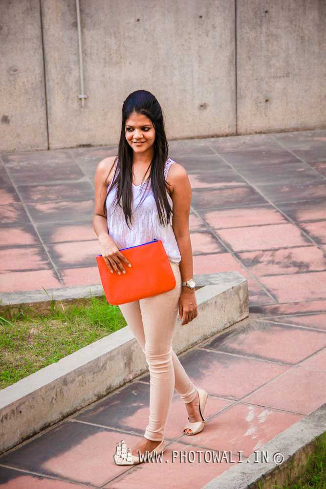 Seen here on Sonal: White Top: Vero Moda Beige Pants: Local boutique in Kolkata Oversized Clutch: Pieces, Vero Moda