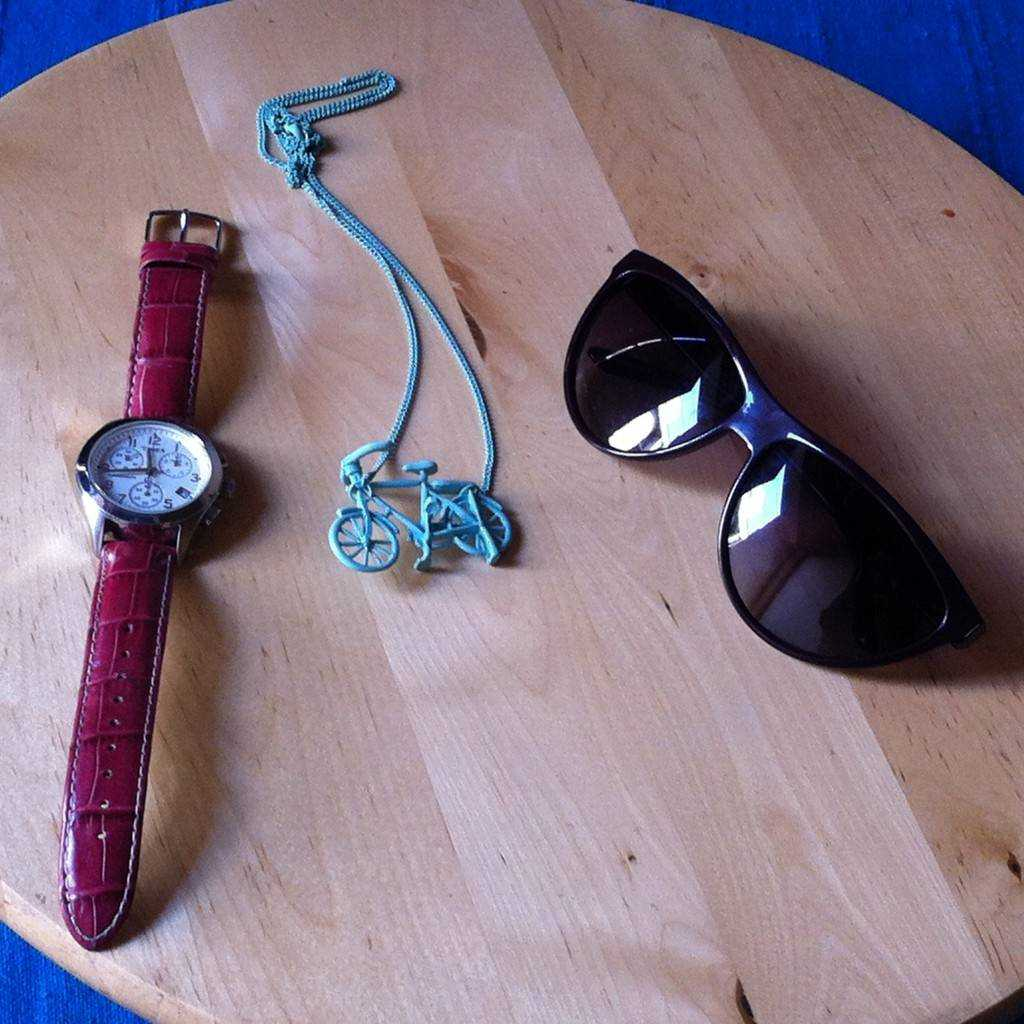 The accessories from left to right: Rose color strap chronograph- Timex Mint necklace- PIECES Purple Cat-eyed Sunnies- AND