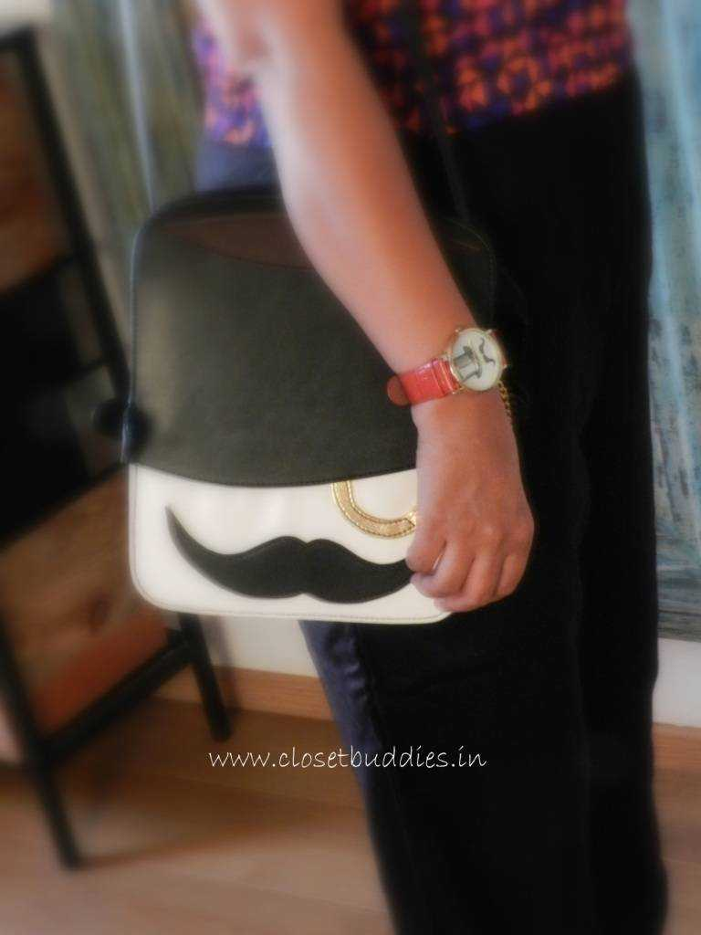 Classy meets quirky? I fell in love with this bag the moment I saw it-reminds me of my favorite character Mr. Hercule Poirot :) Ynots Bag- Stalkbuylove Mustache Watch: House of Blondie