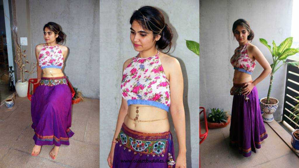 Riya is wearing a floral crop top as choli with a traditional chainya. A side bun and delicate chains around her head and waist look exquisite don't they?